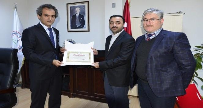 Rektör Özer İlahiyat Fakültesi'ni gezdi