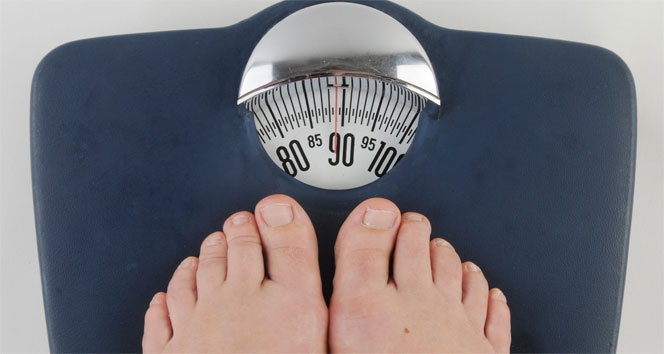 Obezite başarı hissini azaltıp mutsuz ediyor