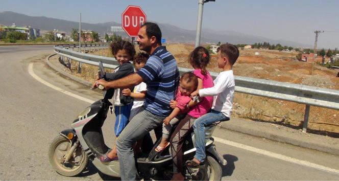 6 kişilik ailenin motosikletle tehlikeli yolculuğu