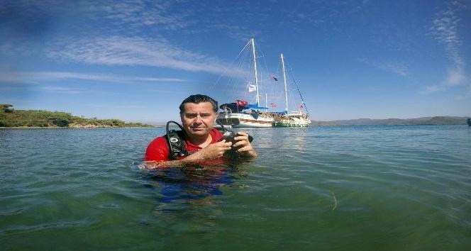 Başkan Kocadon deniz dibine dalıp çöp topladı