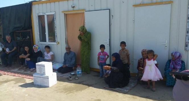 Burhaniye'de 110 aileye gıda yardımı yaptı