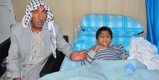 Baba oğul, Suriye'den gelen mermilerle yaralandı