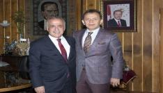 Prof. Dr. Serdar Sevimli ve TRT Türk Halk Müziği Sanatçısı Yavuz Değirmenci Rektör Çomaklıyı ziyaret etti