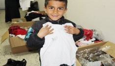 Silvanda öksüz ve yetim çocuklara giyim yardımı