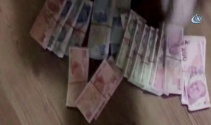 Jandarmaya yakalanmamak için sahte paraları çatıya attılar