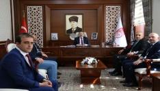 Esnaf Kredi Kefalet yönetim kurulu üyeleri Vali Ali Hamza Pehlivanı ziyaret etti