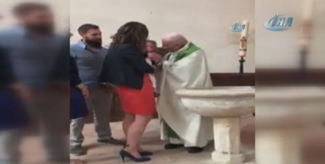 Rahipten bebeğe şoke eden tokat!