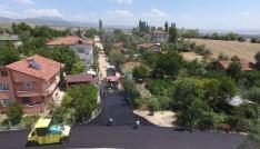 Sokakları asfaltlanan mahalleli kurban kesti
